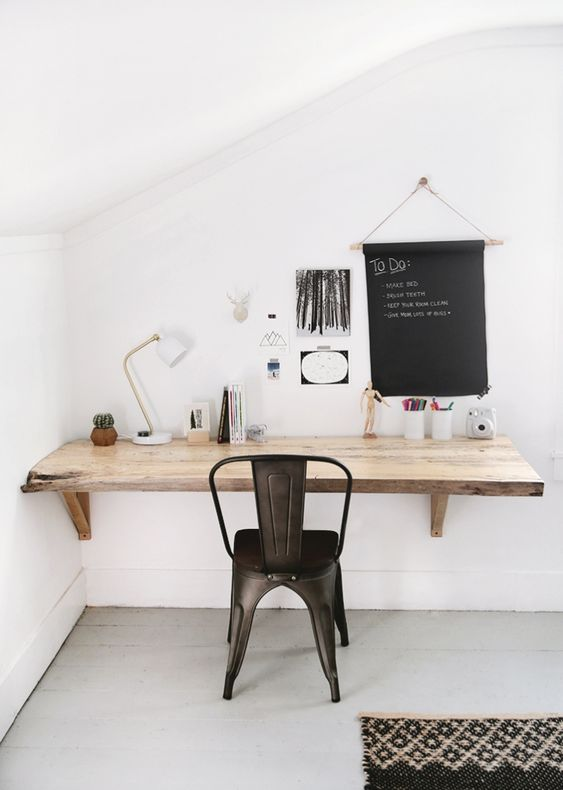 a living edge wall-mounted wooden desk is a smart idea to save some space