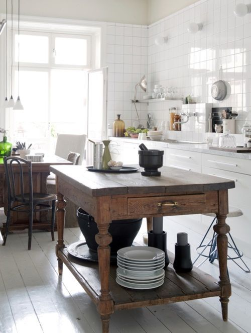 a vintage rustic kitchen island with much storage in a neutral and modern kitchen
