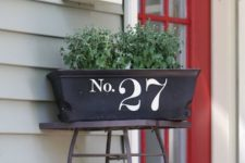 17 stencil or apply vinyl numbers to a planter box next to the front door, this is a quick DIY project with a cool look