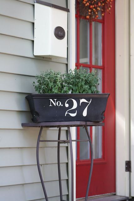 stencil or apply vinyl numbers to a planter box next to the front door, this is a quick DIY project with a cool look
