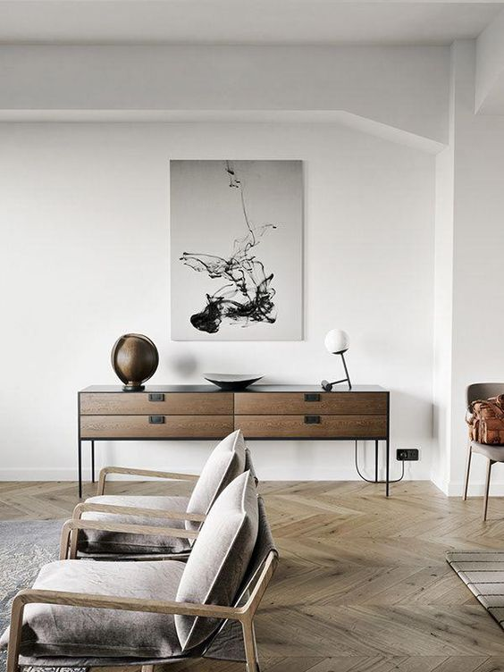 the floor, chairs and a sideboard of complementary wood tones are great for an edgy feel