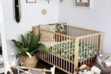 18 a boho nursery with potted greenery, macrame, wicker baskets and a printed rug
