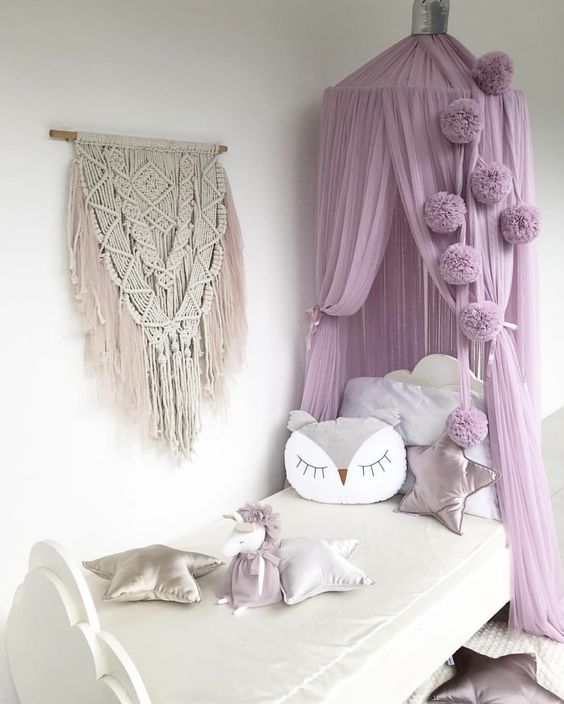 a girl's bedroom with a dreamy lilac canopy over it raises it to a new level