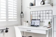 18 a small white sleek desk is a very stylish Scandinavian or minimalist option with a stroage drawer