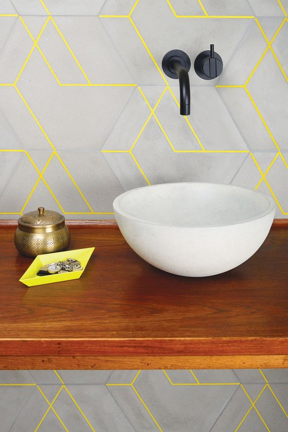 matte grey tiles and neone yellow grout that brings color and pattern to the space at once