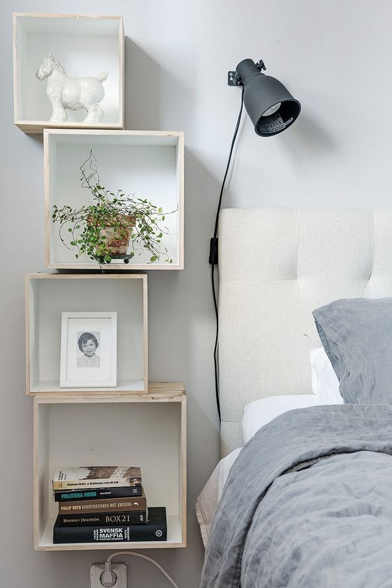 rock an arrangement of box shaped floating nightstands by the bed, it's a very whimsy idea
