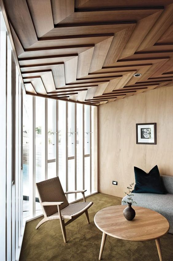 a dimensional wood clad ceiling with a chevron pattern is a bold idea with a modern feel - geometry is very edgy