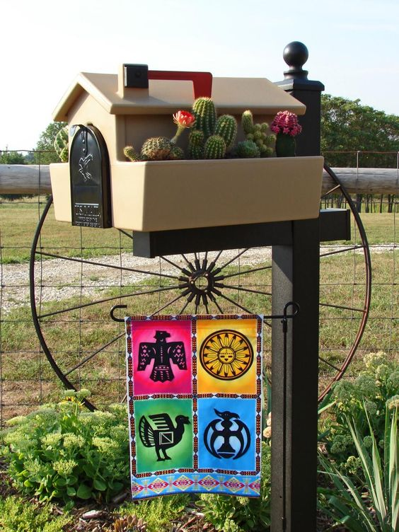 a gorgeous home mailbox with a cacti garden and a colorful Mexican inspired banner