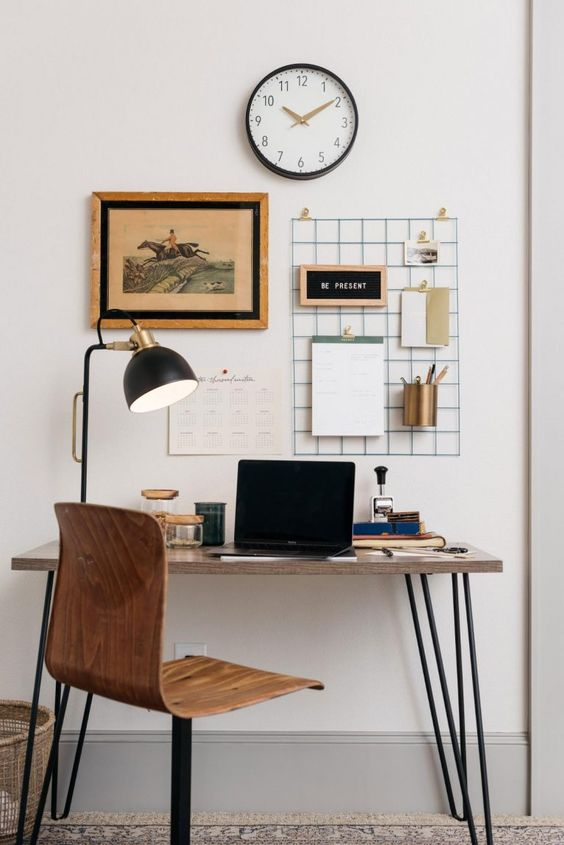 a super sleek desk with hairpin legs and a matching rotating chair are a nice setup for a manly space