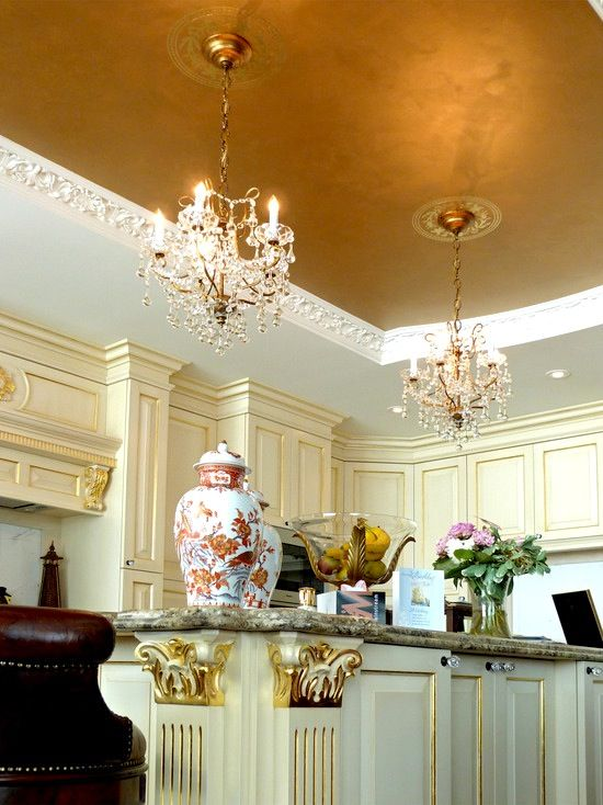 accentuate your kitchen with a chic ceiling decorated with gold leaf and with exquisite chandeliers