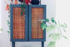 19 an IKEA Ivar cabinet painted blue, placed on tall legs and clad with corks is a bold and very whimsical idea