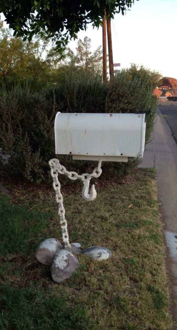 a mailbox being help up by a chain looks as if it's really hanging in the air, so bold and cool