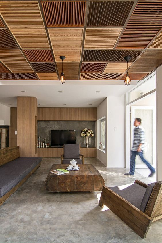 a patchwork ceiling made of wooden shutters done in earthy and muted tones brigns that wow factor to the room