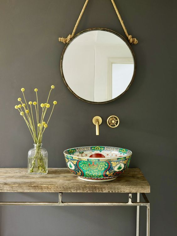 a unique sink of a painted porcelain bowl is a cool idea to add color and pattern to the bathroom