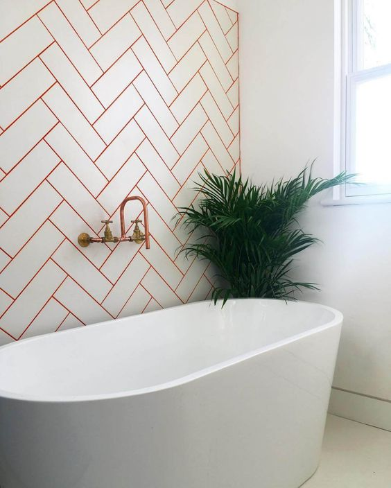 spruce up the chevron pattern with red grout and make your fixtures red to keep the theme