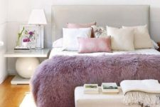 21 a lilac fur throw is a chic accessory for a bedroom, it brings color to the space and can be easily changed