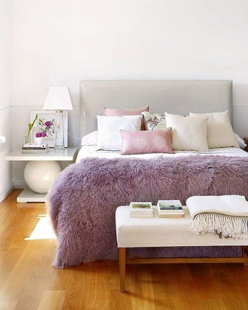 a lilac fur throw is a chic accessory for a bedroom, it brings color to the space and can be easily changed