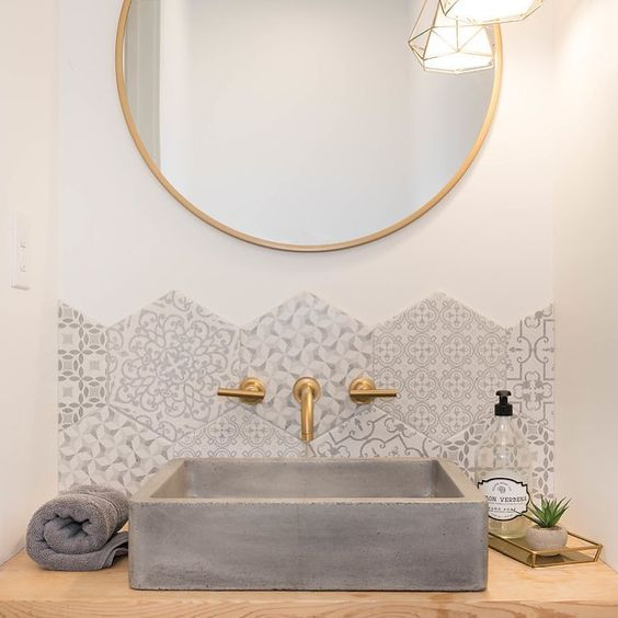 a square concrete sink is a statement idea for such a glam space, it complements its perfectly with its rough texture