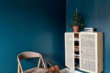 21 an IKEA Ivar cabinet spruced up with hairpin legs and cane doors is a stunning storage piece with an edge