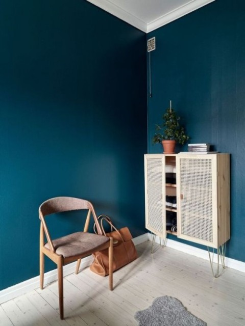 an IKEA Ivar cabinet spruced up with hairpin legs and cane doors is a stunning storage piece with an edge