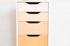 21 renovate an Alex drawer unit with bold contact paper or paints creating a cool ombre effect, here from blush to orange
