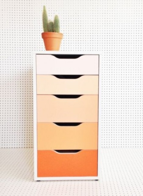 renovate an Alex drawer unit with bold contact paper or paints creating a cool ombre effect, here from blush to orange