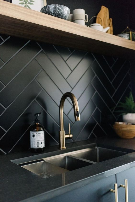 a black tile kitchen herringbone backsplash is a chic idea for a modern space