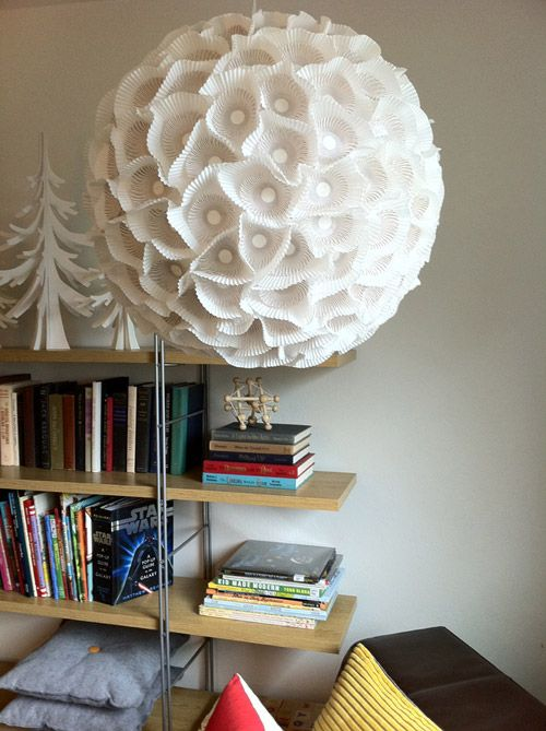 a sculptural paper orb light made of an IKEA Regolit lampshade and some cupcake lines