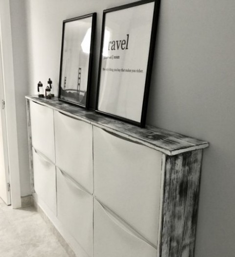 an IKEA Trones cabinet with a whitewashed waterfall countertop is a chic idea to add a Scandinavian feel