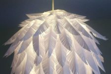 23 a chic paper feather pendant lamp made of an IKEA Regolit lampshade is a cool DIY