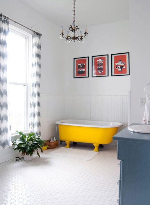 a cozy neutral space with a bold yellow bathtub - you may paint on yourself