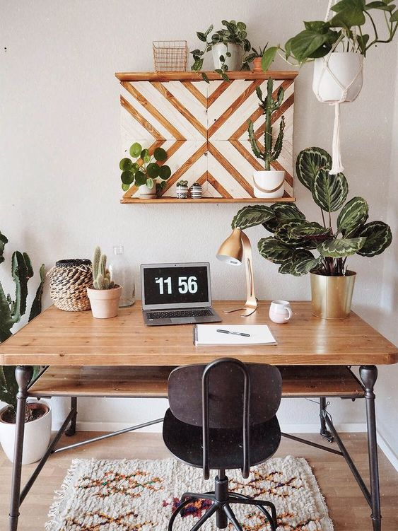 a cute geometric shelf and much potted plants and greenery create a welcoming space in mid-century modern style
