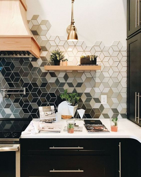 a geometric ombre kitchen tile backsplash makes a monochromatic kitchen bold