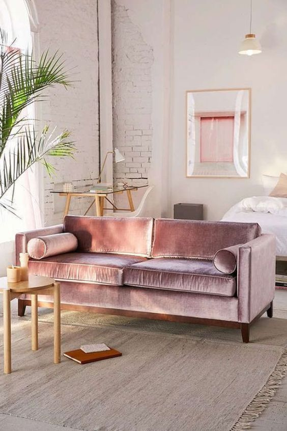 a lilac velvet sofa is a gorgeous color and fabric statement for any space, it looks shiny and bright