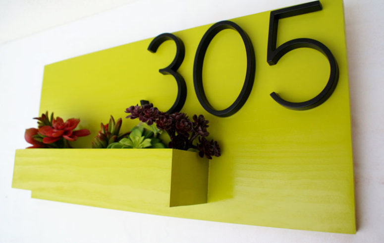 a neon planter with house numbers and succulents and blooms will add a touch of color to your outdoor space
