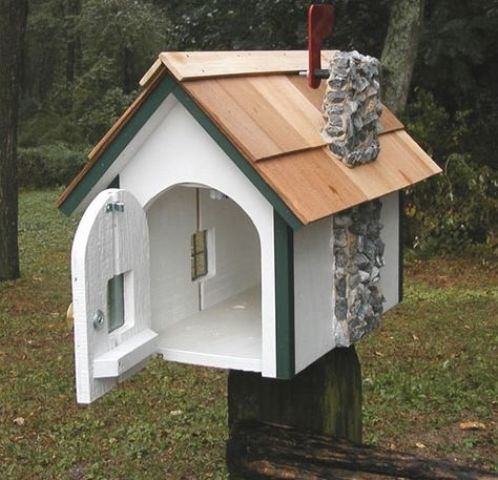 a whimsy mailbox looking like an actual house with even a stone pipe is a fun idea