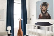 23 a whimsy modern nursery decorated with a leather ottoman, a large toy giraffe, an artwork and rugs