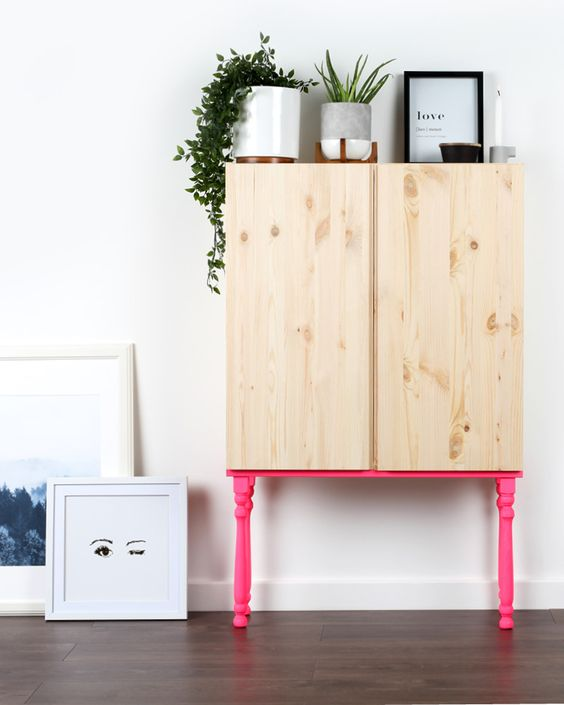 an Ivar cabinet placed on hot pink neon legs is a gorgeous idea, which won't take much time to recreate