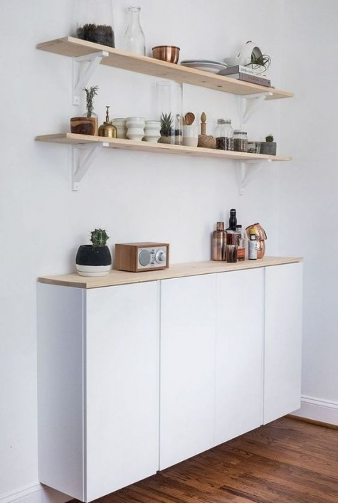 a comfy floating storage cabinet for your kitchen made of two Ivar cabines and finished with a wooden top