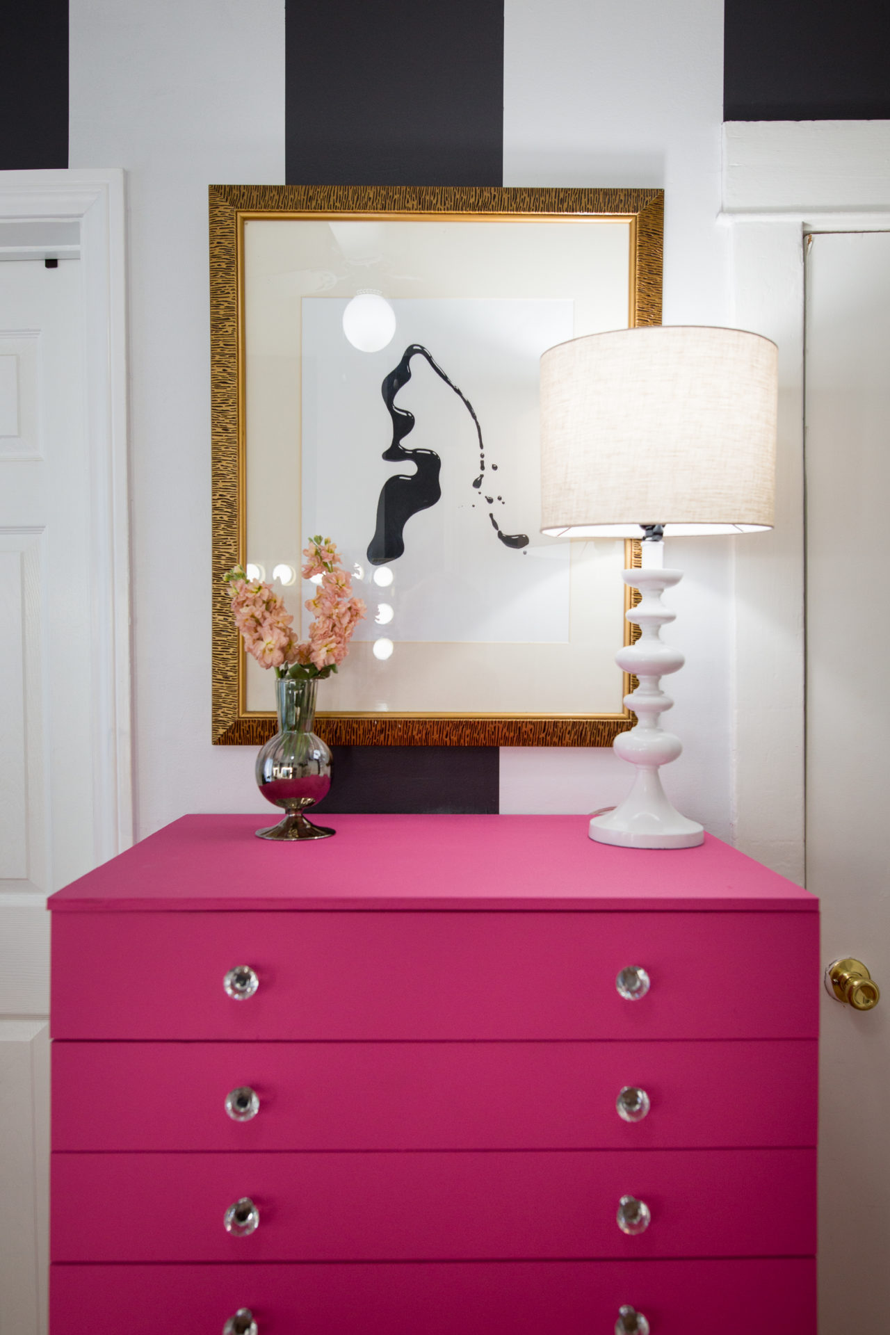 a hot pink dresser made of an IKEA Alex drawer unit with glass knobs for a girlish space