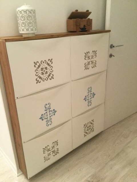 an IKEA Trones shoe cabinet spruced up with colorful stickers and with a wooden waterfall countertop for an entryway