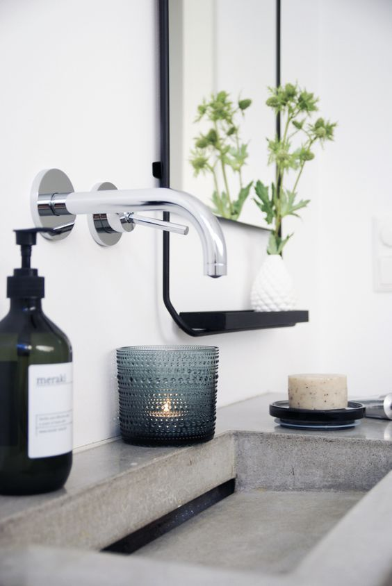 some candles and greenery will add charm to the bathroom
