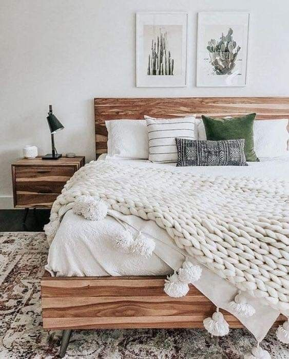 various fabrics, colorful velvet and chunky knit with tassels make the bed eye catchy and inviting
