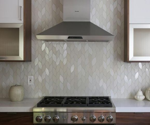 a beautiful mother of pearl kitchen backsplash is a unique idea to go for