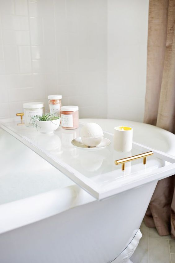 a chic bathroom caddy of lucite will bring a fresh look to your bathroom