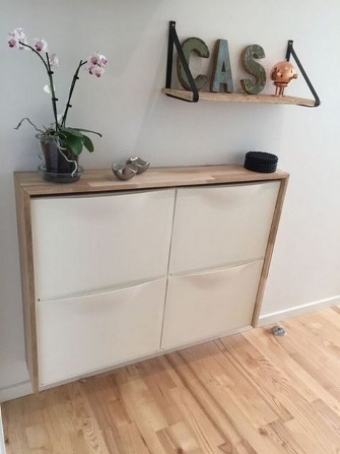 an IKEA Trones storage shelf with a waterfall wood countertop as a floating entryway shelf for a contemporary space