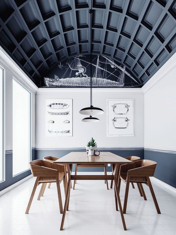 an arched ceiling done with black paneling takes over the whole space and makes a statement