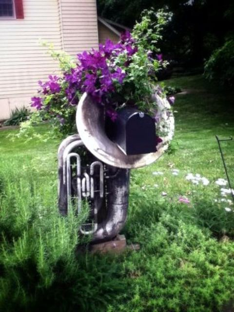 if you are all about music, use an old musaical instrument and some blooms to display your mailbox in a chic way