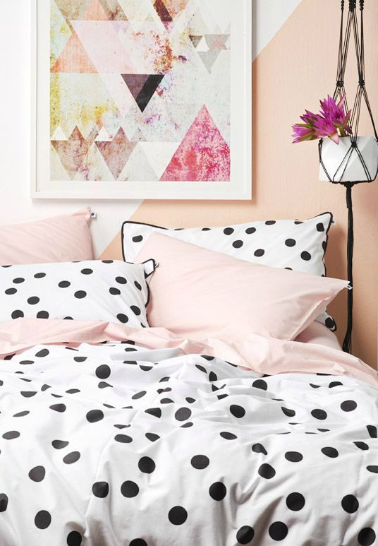 large polka dots with a black edge and pink bedding set for a playful feel in a girlish room