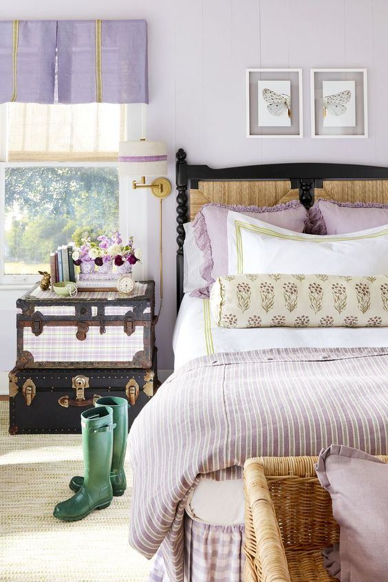 lilac curtains, pillows and a blanket are simple and cute accessories for a woman's bedroom